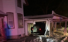 A pickup truck crashed into a vacant house after hitting two hydro poles on Denfield Road, January 23, 2021. Photo courtesy of Middlesex OPP.