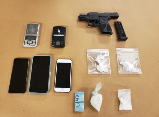 A handgun and various drugs seized by London police during the search of a home on Briscoe Street East, January 28, 2021. Photo courtesy of London police.