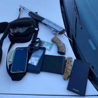 A sawed-off rifle, brass knuckles and drugs seized during an arrest downtown, January 7, 2021. Photo courtesy of London police.