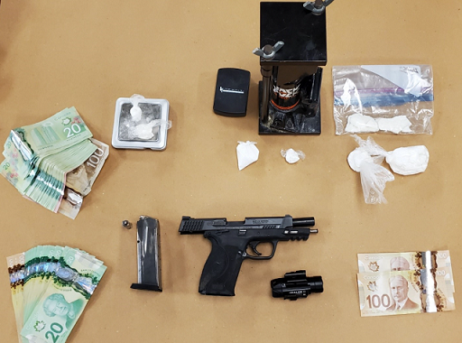 A loaded handgun and drugs seized during a raid in east London, February 18, 2021. Photo courtesy of London police.
