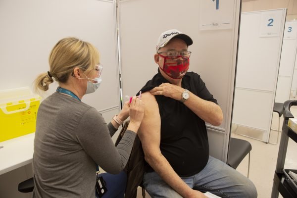 Rich Michaud, from Tillsonburg gets his COVID-19 vaccine at Gof Hall in Woodstock. March 15, 2021. (File photo supplied by Southwestern Public Health)