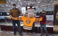 Chef Kevin Allen (left) and 10-year-old Kaleb Orrange (right) being recognized as the winners of the Sarnia Sting and Esso Extra Mile campaign. March 2021. (Photo by Metcalfe Photography)
