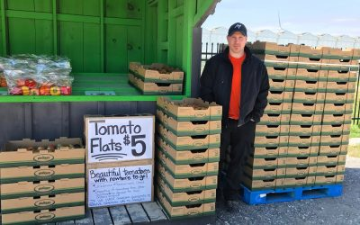 Tim Verbeek at Platinum Produce's roadside stand on Communication Road. (Photo via Platinum Produce on Facebook)