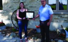 Gracie Goodhill, the recipient of the 2020 Mary Jo Arnold Conservation Scholarship, receives her award from SCRCA Chair, Joe Faas. (Submitted Photo)