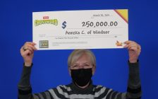 Anezka Clark of Windsor shows off her $250,000 cheque for playing Crossword Deluxe, at the OLG Prize Centre in Toronto, April 6,2021. Photo provided by OLG.