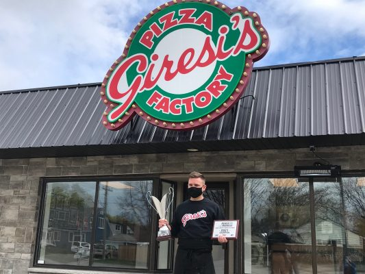 Mike Giresi showing off his 'MUNCH MADNESS Sarnia Lambton's Favourite Restaurant' trophy and plaque. April 2021. (Photo by Cool 106.3)