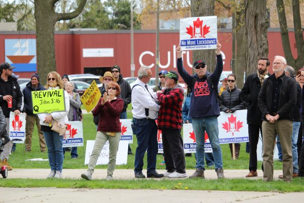 Independent MPP Randy Hillier (White shirt, centre) embraces a supporter at a No More Lockdowns Canada rally at Tecumseh Park in Chatham. April 26, 2021. (Photo by Matt Weverink)