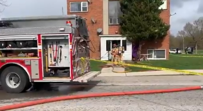 Firefighters battle a fire at a three-storey walk-up on King Edward Avenue, April 21, 2021. Photo from the London Fire Department.