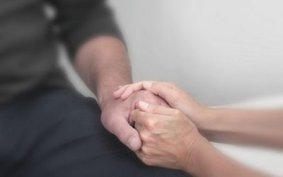 One person comforts another. File photo courtesy of © Can Stock Photo / Nikki24