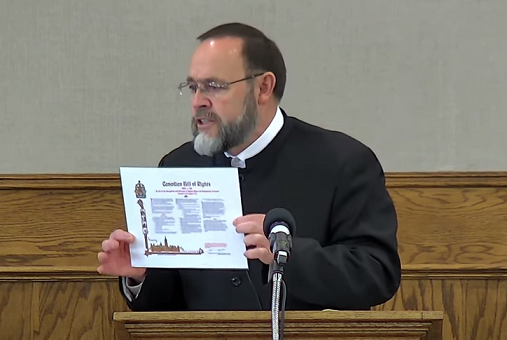 Church of God Pastor Henry Hildebrandt holds up the Canadian Bill of Rights at a service on May 2, 2021. Screen capture from Hildebrandt's YouTube channel.