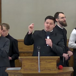 Churchgoers seen signing during an in-person service at the Church of God in Aylmer, May 2, 2021. Screen capture from Hildebrandt's YouTube channel.