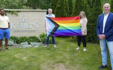 King's Board of Directors Chair Kapil Lakhotia, LGBTQ2S+ advisory group member Thomas Gray, Holly Clarke, the President of King's University College Students' Council, and Dr. David Malloy, the Principal of King's University College, unveil the Pride flag that will fly at King's