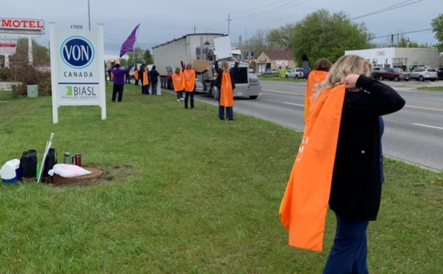 Striking VON Sarnia-Lambton employees don superhero capes on the picket lines. 5 May 2021. (Photo from LiUNA! Local 3000's Twitter page)