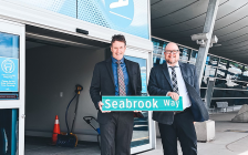 Mike Seabrook, (left) holding the street sign for Seabrook Way, the new name for the main road at London International Airport. (Photo supplied by flylondon.ca)
