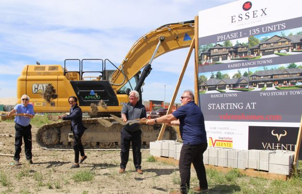 Essex Mayor Larry Snively, second from right, helps break ground on a new housing development on June 16, 2021. Photo provided by Town of Essex.