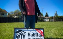 Melanie Dramnitzke with her Habitat for Humanity sold sign in Dresden (Photo courtesy Habitat for Humanity Chatham-Kent)