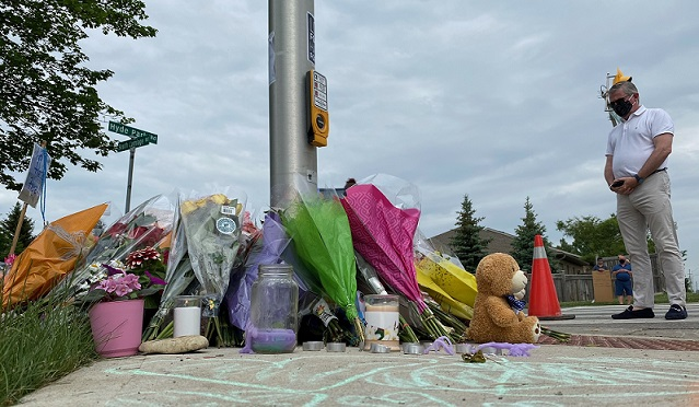 A memorial continues to grow at the corner of Hyde Park and South Carriage roads in honour of a Muslim family who was run down Sunday night, June 8, 2021. Photo by Blair Henatyzen.