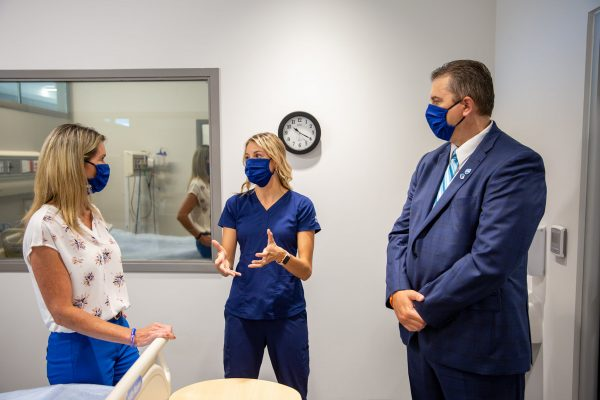 RPN and Lambton College student Courtney Cheswick speaking with MPP Jill Dunlop and Lambton College President and CEO Rob Kardas. 21 July 2021. (Photo by Lambton College)