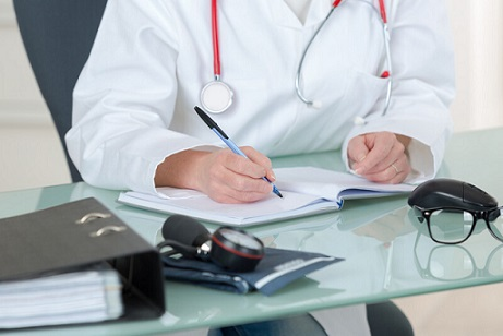 A doctor writing notes. File photo courtesy of © Can Stock Photo / photography33.