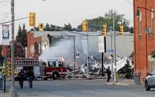 An explosion in downtown Wheatley brings a building down to rubble. BlackburnNews.com file photo by Kari Matheson.