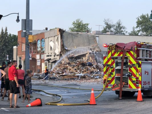 An explosion in downtown Wheatley brings a building down to rubble and severely damages surrounding structures. (Photo credit: Kathryn Parent, Photography by Phos³ via Twitter)