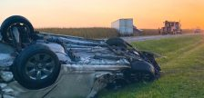 A vehicle on its roof and a transport in a field following a two-vehicle crash in Plympton-Wyoming. 17 September 2021. (Photo by OPP West Region)