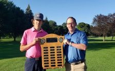 Sarnia Golf Associate Pro Jeff Yates (right) presents Liam Crummy (left) with the plaque for the Junior Boys Club Championship. August 2021. (Photo by SGCC)
