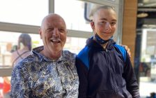 Former Big Brothers Big Sisters of Sarnia-Lambton Ex. Director Mike Hurry with his Little Brother, Eddie, during Mike's hair fundraising event. 15 August 2021. (Photo by BBBS of SL)