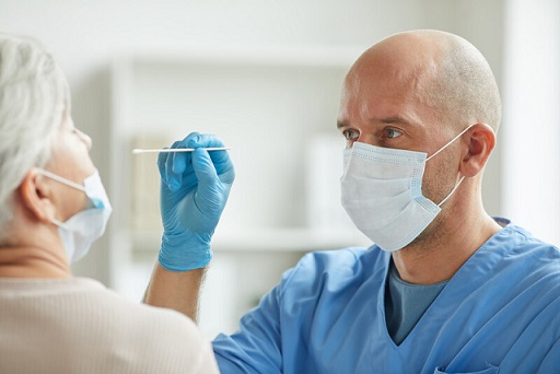 A doctor performs a nasal swab test for COVID-19. File photo courtesy of © Can Stock Photo / SeventyFour