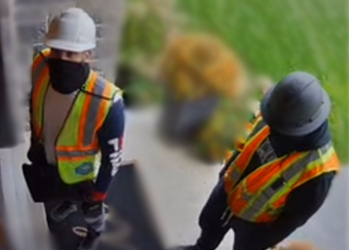 Two men dressed as construction workers wanted in connection with an armed robbery in Woodstock, October 14, 2021. Photo courtesy of Woodstock police.