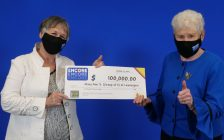 Mary Ann Sherman of Leamington and Donna Urbantke of London show off their $100,000 cheque at the OLG Prize Centre in Toronto, October 20, 2021. Photo provided by OLG.