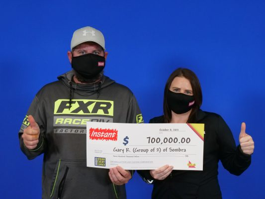Gary Rankin and Ashley Bird of Sombra celebrate after winning a $700,000 top prize with INSTANT SUPREME 7. October 2021. (Photo provided by OLG)